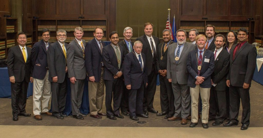 Academy inductees pose with UConn engineering leadership. From left is UConn Provost Mun Choi, electrical and computer engineering Department Head Rajeev Bansal, Dean Kazem Kazerounian, Ken Bowes, John Schneiter, Kartik Chandran, John Augustyn, Andrew Hoffman, William D'Agostino, Manish Gupta, Konstantinos G. Zografos, Christopher Ecsedy, Scott Tyler, Associate Dean for Undergraduate Education and Diversity Daniel Burkey, Senior Associate Dean Michael Accorsi, Associate Dean for Research and Graduate Education Mei Wei, Chemical and biomolecular engineering Department Head Ranjan Srivastava (Photo: Chris LaRosa, UConn School of Engineering)